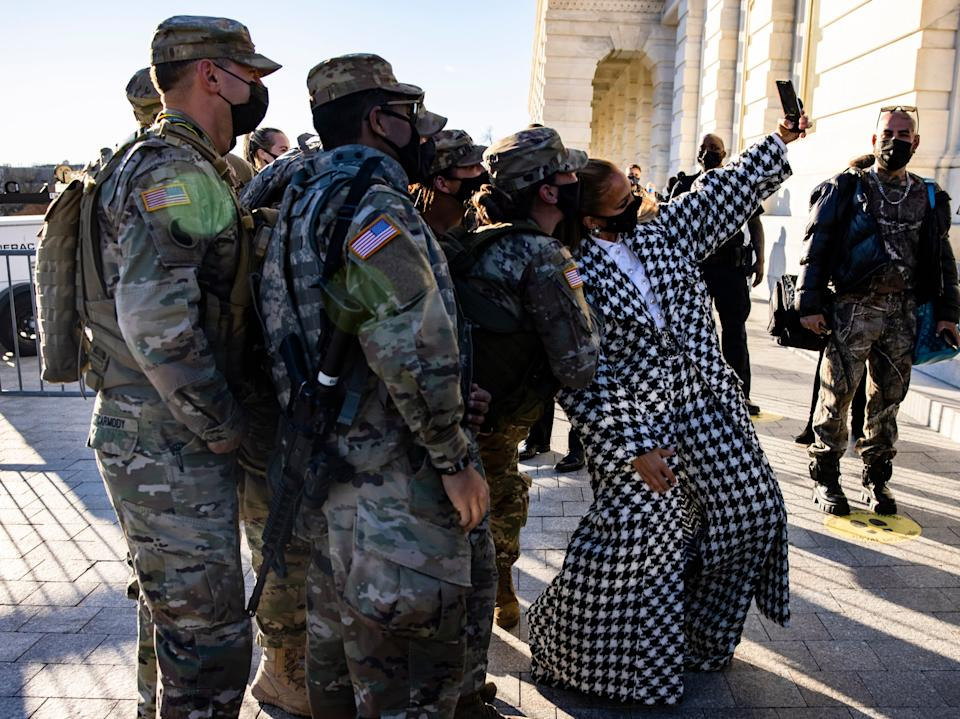 Jennifer Lopez stops to take a selfie with a group fo Maryland National Guard soldiers as she leaves the US Capitol buildingEPA
