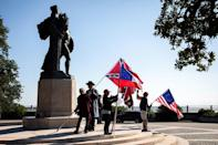 A small group waves Confederate battle flags every weekend in Charleston, South Carolina, a reminder -- even in the run up to a divisive US presidential election on November 3, 2020 -- of the era when slavery tore the nation apart