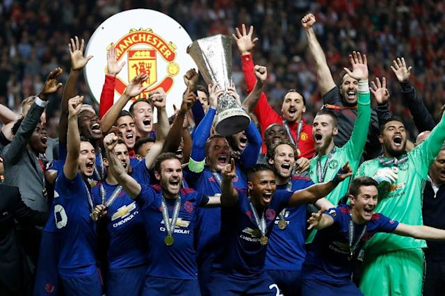 Manchester United's players celebrate with the Europa league trophy after winning their final against Ajax Amsterdam on May 24, 2017 at the Friends Arena in Solna outside Stockholm (AFP Photo/Odd ANDERSEN)