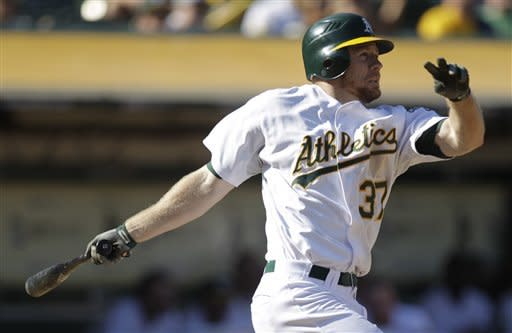 Oakland Athletics' Brandon Moss swings for a double off Seattle Mariners' Tom Wilhelmsen in the eighth inning of a baseball game Saturday, Sept. 29, 2012, in Oakland, Calif. Oakland won 7-4 in 10 innings. (AP Photo/Ben Margot)