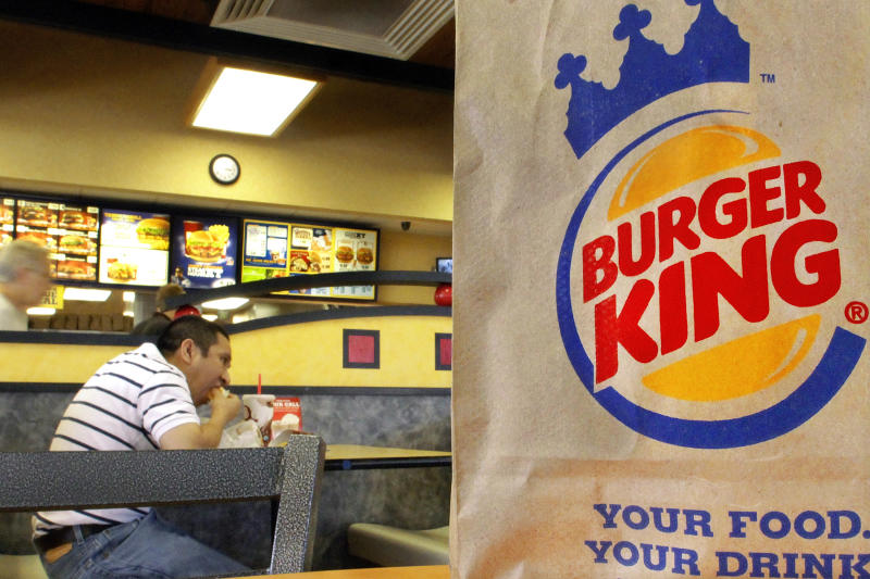FILE - In this Aug. 24, 2010 file photo, patrons enjoy a meal at a Burger King in Springfield, Ill.  The movement by U.S. food corporations toward more humane treatment of animals experienced a whopper of a shift Wednesday, April 25, 2012,  when Burger King announced that all of its eggs and pork will come from cage-free chickens and pigs by 2017. The decision by the world's second-biggest fast-food restaurant raises the bar for other companies seeking to appeal to the rising consumer demand for more humanely produced fare.(AP Photo/Seth Perlman)