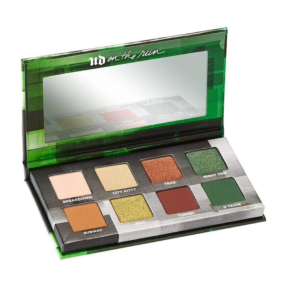 """<p>Urban Decay has added, not one, but <em>two</em> new items to its roster of miniature On the Run Eye Shadow Palettes. Shown above is G-Train, a collection of green and neutral shades inspired by New York City's train line of the same name. The other is Highway Queen, a scorching set of rusts and coppers like that of a desert landscape.</p> <p><strong>$25</strong> (<a href=""""https://www.urbandecay.com/on-the-run-mini-palette-urban-decay/ud932.html?cgid=new#start=1&cgid=new"""" rel=""""nofollow"""">Shop Now</a>)</p>"""