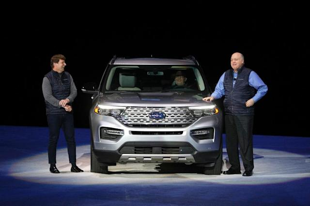 Ford CEO Jim Hackett (R), Jim Farley, president of global markets, unveiled the 2020 Ford Explorer SUV, part of its restructuring to focus on trucks and SUVs (AFP Photo/BILL PUGLIANO)