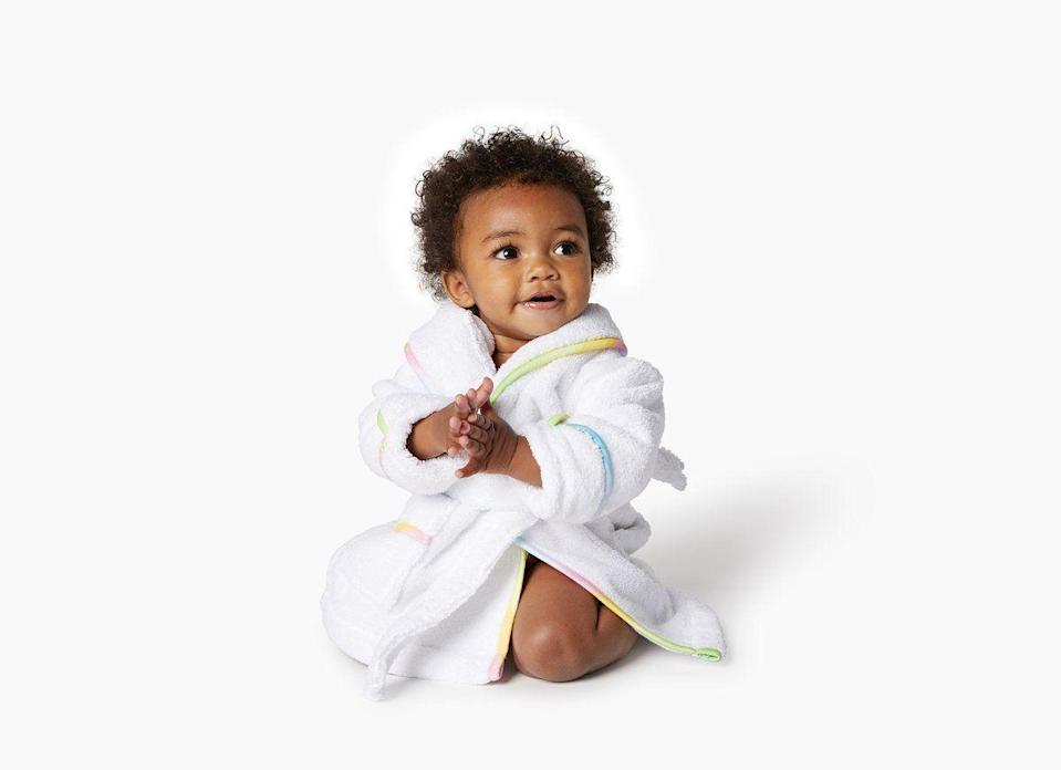 """<p>hillhousehome.com</p><p><strong>$50.00</strong></p><p><a href=""""https://www.hillhousehome.com/products/the-childrens-hotel-robe"""" rel=""""nofollow noopener"""" target=""""_blank"""" data-ylk=""""slk:Shop Now"""" class=""""link rapid-noclick-resp"""">Shop Now</a></p><p>Even toddlers deserve a little luxury. This plush robe with rainbow trim can be customized with initials. </p>"""