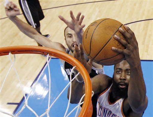 Oklahoma City Thunder guard James Harden (13) shoots as San Antonio Spurs shooting guard Manu Ginobili (20), of Argentina, defends during the first half of Game 6 in the NBA basketball Western Conference finals, Wednesday, June 6, 2012, in Oklahoma City. (AP Photo/Jim Young, Pool)