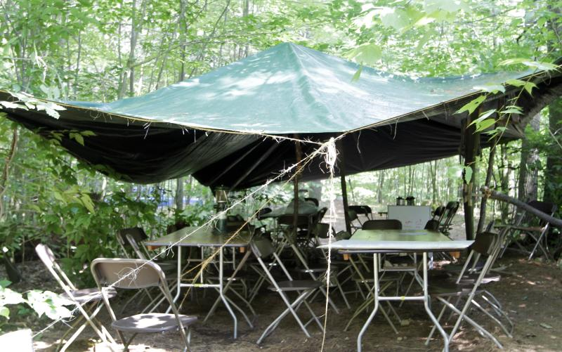 A covered area with tables and chairs is seen Tuesday June 25, 2013 in Gilmanton, N.H. where the evening before a group of Boy Scouts seeking protection from a pouring rain storm suffered burns during a campground lightning strike. Twenty three scouts were taken to area hospitals, none with serious injuries. (AP Photo/Jim Cole)