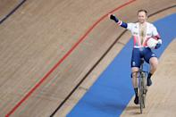 <p>Britain's Jason Kenny waves after winning gold in the Men's Track Cycling Keirin Final during the Tokyo 2020 Olympic Games.</p>