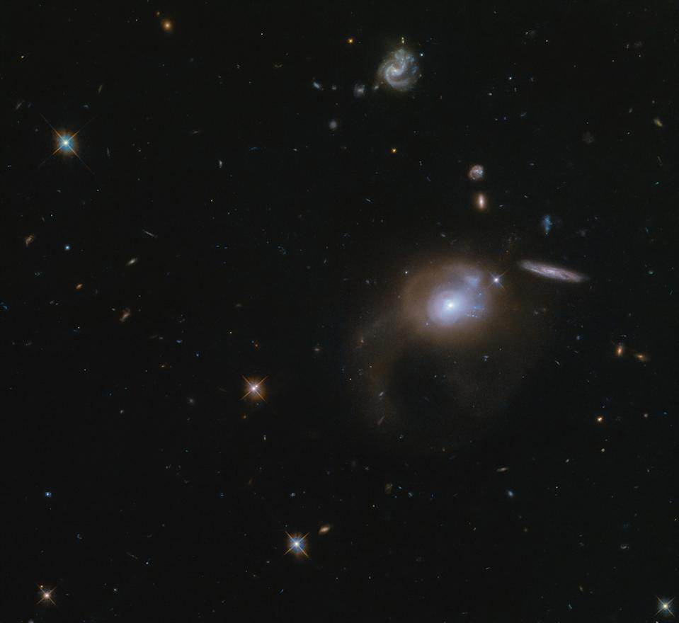 In this image taken by the Hubble Space Telescope, you can see the sparkling, sprawling wonder of space. Featured in this image is the galaxy SDSS J225506.80+005839.9. This galaxy with its long (not exactly catchy) name can be seen in the center right of this image. The recently discovered galaxy lies about 500 million light-years from Earth and is a perfect example of what can be discovered by space telescopes like Hubble.