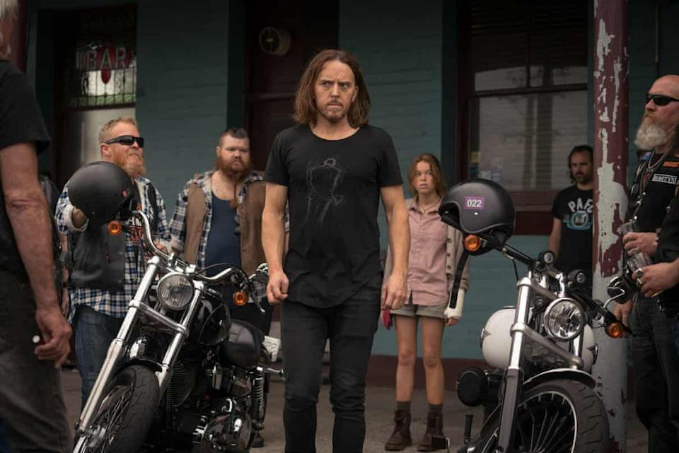 Lucky (Tim Minchin) wonders if owning the complete boxset of Sons of Anarchy will get him out of this one. Photo: Binge.