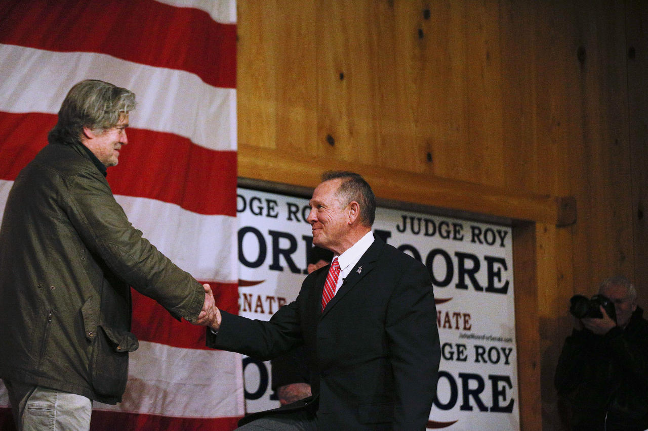 FILE - In a Tuesday, Dec. 5, 2017 file photo, Steve Bannon, left, introduces U.S. senatorial candidate Roy Moore, right, during a campaign rally, in Fairhope, Ala. Dogged by allegations of sexual misconduct, Moore has kept to events with limited publicity and shunned contact with the traditional media in the heated race for U.S. Senate. (AP Photo/Brynn Anderson, File)