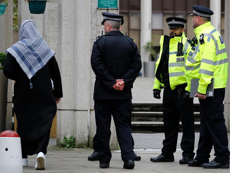 Police officers stand guard as worshippers arrive for Friday Prayers at London Central Mosque near Regent's Park in London on February 21, 2020: (Photo by TOLGA AKMEN/AFP via Getty Images)