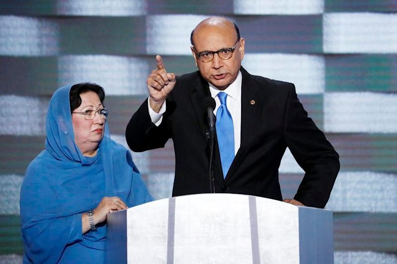 FILE- In this July 28, 2016, file photo, Khizr Khan, father of fallen U.S. Army Capt. Humayun S. M. Khan, accompanied by his wife Ghazala speaks at the Democratic National Convention in Philadelphia. President Donald Trump signed into law a bill naming a Virginia post office for Humayun Khan, whose father criticized the then-candidate in a 2016 Democratic National Convention speech. (AP Photo/J. Scott Applewhite, File)
