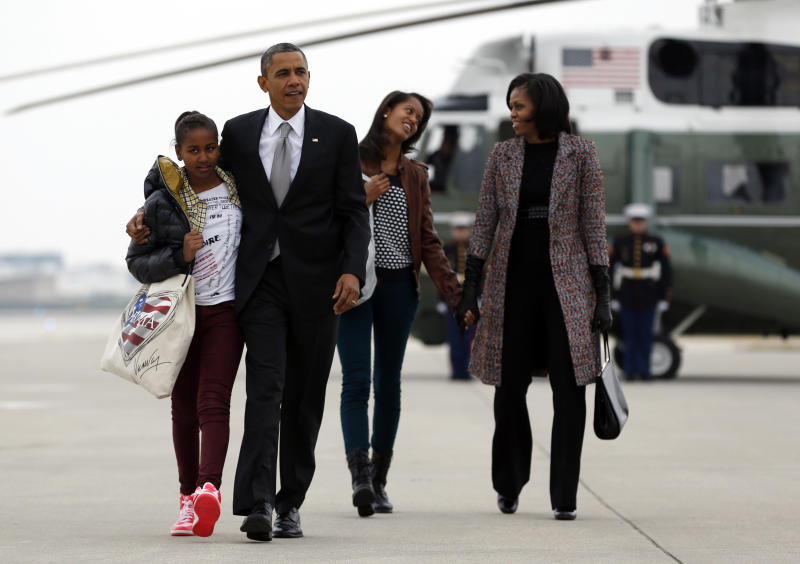 President Barack Obama, first lady Michelle Obama and their daughters Sasha and Malia, walk from Marine One to board Air Force One at Chicago O'Hare International Airport, Wednesday, Nov. 7, 2012, in Chicago, the day after the presidential election. Obama defeated Republican challenger former Massachusetts Gov. Mitt Romney. (AP Photo/Carolyn Kaster)