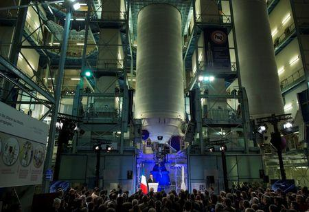 French President Francois Hollande delivers a speech in front of two giant rocket boosters in a factory warehouse at Airbus Safran Launchers in Les Mureaux, France, November 14, 2016.    REUTERS/Ian Langsdon/Pool