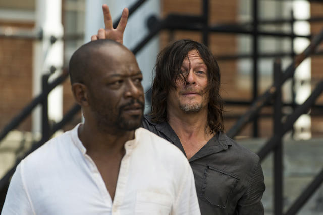 <p>While filming on the Kingdom set, Norman Reedus makes bunny ears on co-star Lennie James.<br><br>(Photo: AMC) </p>