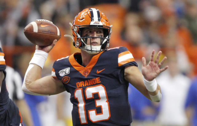 FILE - In this Friday, Oct. 18, 2019, file photo, Syracuse's Tommy DeVito passes the ball during the first quarter of the team's NCAA college football game against Pittsburgh, in Syracuse, N.Y. DeVito is ready to turn the page on the 2019 season. (AP Photo/Nick Lisi, File)