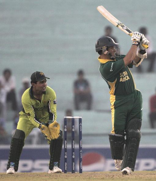 MOHALI, INDIA - OCTOBER 27: Mark Boucher of South Africa is watched by Kamran Akmal as he hits out at the bowling of Muhammad Haffez of Pakistanduring the ICC Champions Trophy match between South Africa and Pakistan at The Punjab Cricket Association Stadium on October 27, 2006, in Mohali, India. (Photo by Julian Herbert/Getty Images)