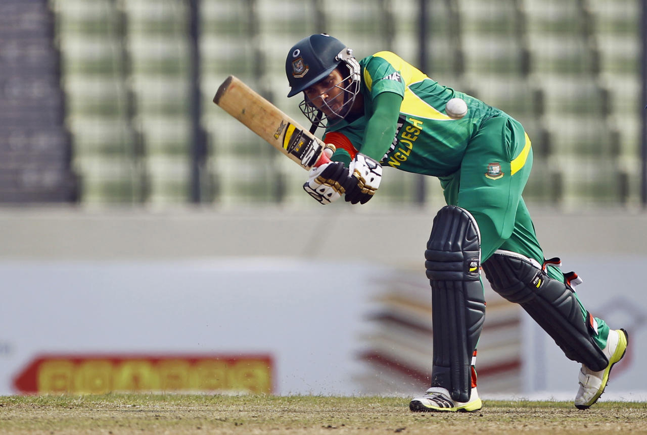 Bangladeshi Shamsur Rahman plays a shot during the third one day international cricket match against Sri Lanka in Dhaka, Bangladesh, Saturday, Feb. 22, 2014. (AP Photo/A.M. Ahad)