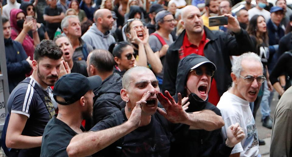 Demonstrators protest against the government's introduction of the