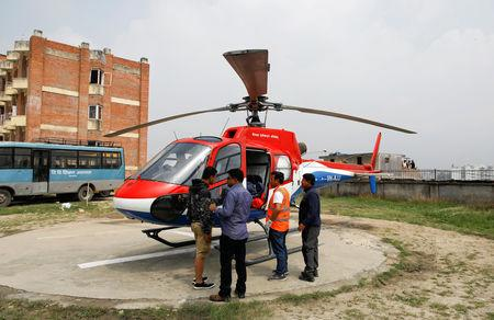 A helicopter carrying the bodies of the victims of a small aircraft belonging to Summit Air, that crashed with a helicopter parked at Lukla airport, waits to get transported for postmortem examination at a hospital in Kathmandu, Nepal April 14, 2019. REUTERS/Navesh Chitrakar