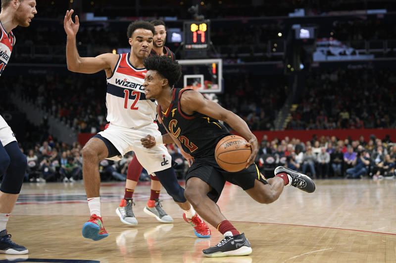 Cleveland Cavaliers guard Collin Sexton (2) dribbles the ball next to Washington Wizards guard Jerome Robinson (12) during the first half of an NBA basketball game Friday, Feb. 21, 2020, in Washington. (AP Photo/Nick Wass)