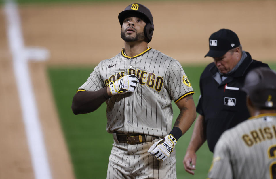 FILE - In this July 31, 2020, file photo, San Diego Padres' Tommy Pham celebrates as he crosses home plate after hitting a three-run home run off Colorado Rockies relief pitcher Wade Davis in the ninth inning of a baseball game, in Denver. Padres outfielder Tommy Pham is recovering after he was stabbed in the back Sunday night, Oct. 11, 2020. Police tell the San Diego Union-Tribune that Pham was stabbed outside a gentlemen's club in San Diego. (AP Photo/David Zalubowski, File)