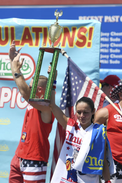 Michelle Lesko reacts after receiving her second-place trophy after the women's competition of Nathan's Famous July Fourth hot dog eating contest, Thursday, July 4, 2019, in New York's Coney Island. (AP Photo/Sarah Stier)