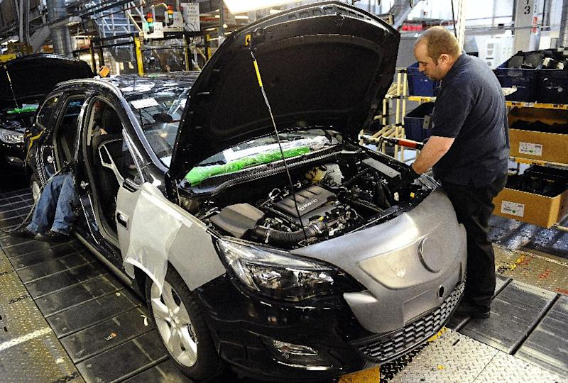 British economic growth to 0.7 percent in the third quarter of 2014, official data showed on December 23, 2014 (AFP Photo/Paul Ellis)