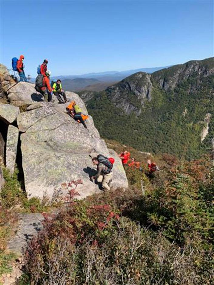 NH Fish and Game Conservation Officers, Mountain Rescue Service members and Pemi Valley Search and Rescue Team members look for a fallen climber in Franconia, N.H., on Sept. 21, 2020. (N.H. Fish and Game)