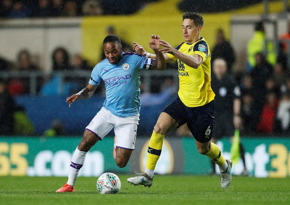 """Soccer Football - Carabao Cup - Quarter Final - Oxford United v Manchester City - Kassam Stadium, Oxford, Britain - December 18, 2019  Manchester City's Raheem Sterling in action with Oxford United's Alex Rodriguez    Action Images via Reuters/John Sibley  EDITORIAL USE ONLY. No use with unauthorized audio, video, data, fixture lists, club/league logos or """"live"""" services. Online in-match use limited to 75 images, no video emulation. No use in betting, games or single club/league/player publications.  Please contact your account representative for further details."""