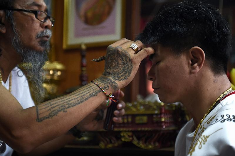Today's Thai 'hermits' are more connected than ever: armed with smart phones, Facebook profiles and business-savvy, a new crop of mystics are harnessing tech to cultivate followings across Asia. (AFP Photo/Lillian SUWANRUMPHA)
