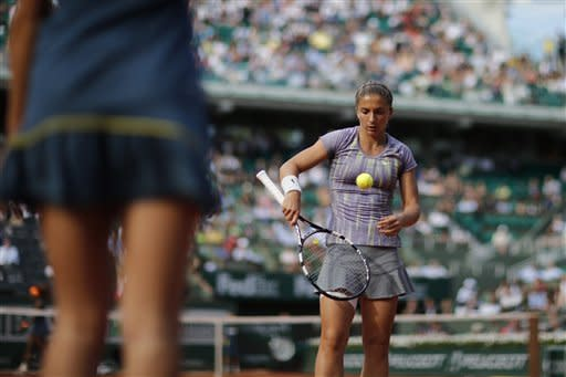Italy's Sara Errani checks a ball as she plays Serena Williams, of the U.S, during their semifinal match of the French Open tennis tournament at the Roland Garros stadium Thursday, June 6, 2013 in Paris. (AP Photo/Christophe Ena)