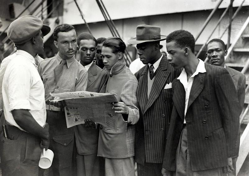 Some of the first immigrants from the Caribbean island of Jamaica arrive at Tilbury, London, on board the