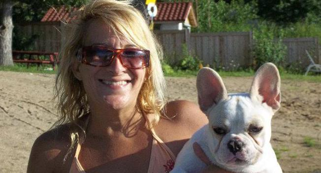 Lisa Urso, 52, pictured with a French Bulldog.