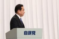 Newly elected Japan's ruling Liberal Democratic Party (LDP) leader Fumio Kishida holds a news conference after the leadership election, in Tokyo
