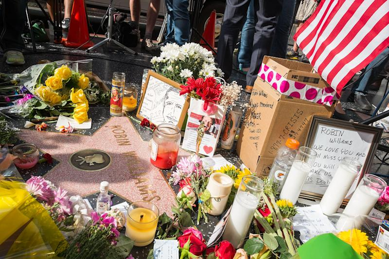 Flowers are placed on Robin Williams' star on the Hollywood Walk of Fame on August 12, 2014 in Los Angeles, California (AFP Photo/Valerie Macon)