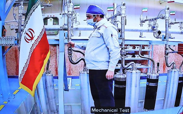 An engineer inside the Natanz uranium enrichment plant, shown on TV locally as part of a ceremony to mark Iran's National Nuclear Technology Day on April 10 - AFP