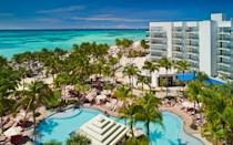 """<p>Any guest at <a rel=""""nofollow noopener"""" href=""""http://www.marriott.com/hotels/travel/auaar-aruba-marriott-resort-and-stellaris-casino/"""" target=""""_blank"""" data-ylk=""""slk:the Aruba Marriott Resort"""" class=""""link rapid-noclick-resp"""">the Aruba Marriott Resort</a> can request a Wellness Upgrade to their room, which includes a yoga mat, healthy snacks, <a rel=""""nofollow noopener"""" href=""""http://www.travelandleisure.com/hotels-resorts/all-inclusive-resorts/all-inclusive-aruba-resorts"""" target=""""_blank"""" data-ylk=""""slk:Aruba"""" class=""""link rapid-noclick-resp"""">Aruba</a> Aloe products and a zen coloring book. The resort also offers a Wellness Retreat Package (starting at <a rel=""""nofollow noopener"""" href=""""http://www.marriott.com/hotels/hotel-deals/auaar-aruba-marriott-resort-and-stellaris-casino/"""" target=""""_blank"""" data-ylk=""""slk:$328 a night"""" class=""""link rapid-noclick-resp"""">$328 a night</a>) with a private healthy cooking class and a private yoga class on the beach.</p> <p>The resort also offers fitness classes around the property and on the beach, including tennis, step, aqua zumba or yoga. Nearby guests can also try out stand up paddleboard yoga, snorkeling, snuba, kayaking, beach tennis, kitesurfing and windsurfing.</p>"""