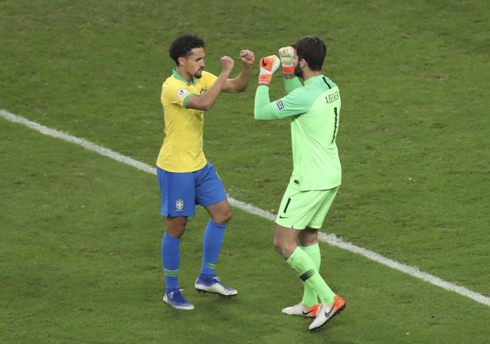 Brazil's Marquinho, left, and his goalkeeper Alison celebrate during a penalty shoot-out against Paraguay at a Copa America quarterfinal soccer match at the Arena do Gremio in Porto Alegre, Brazil, Thursday, June 27, 2019. Brazil won the game 4-3. (AP Photo/Ricardo Mazalan)