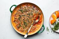 """Silky miso and a paprika-packed squash purée makes this dairy-free risotto hearty and satisfying. It's a worthy main dish for a vegan Thanksgiving, or a wonderful side for anyone who likes squash. <a href=""""https://www.epicurious.com/recipes/food/views/creamy-squash-risotto-with-toasted-pepitas?mbid=synd_yahoo_rss"""" rel=""""nofollow noopener"""" target=""""_blank"""" data-ylk=""""slk:See recipe."""" class=""""link rapid-noclick-resp"""">See recipe.</a>"""