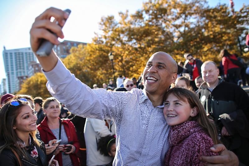 US Senator Cory Booker, seen here taking a selfie, is the latest Democrat to seek the 2020 presidential nomination (AFP Photo/KENA BETANCUR)