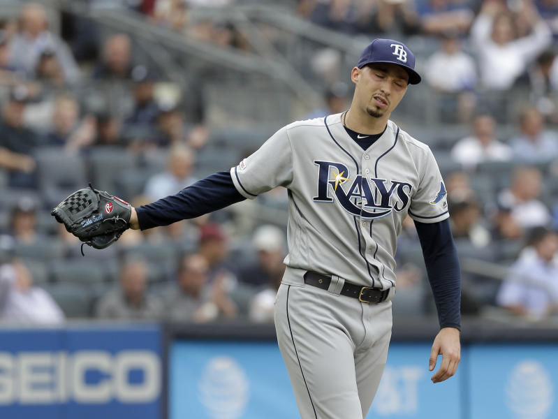 Tampa Bay Rays starting pitcher Blake Snell reacts after walking a batter during the first inning of a baseball game against the New York Yankees at Yankee Stadium, Wednesday, June 19, 2019, in New York. (AP Photo/Seth Wenig)
