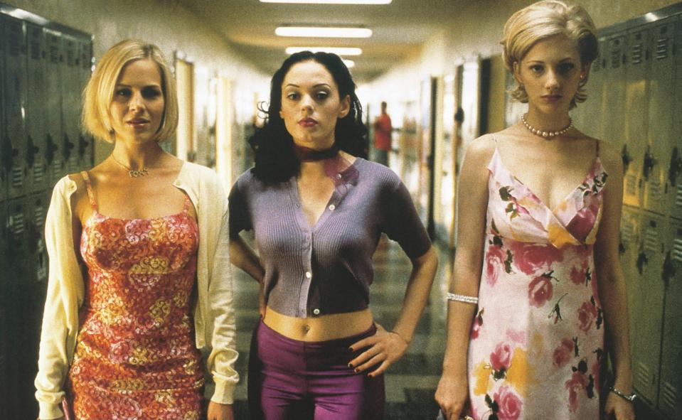 "<p>If <em>Mean Girls</em> and <em>Heathers</em> had a baby—and the baby wore everything in the Delia's catalog and had a thing for John Waters movies—that baby would be <em>Jawbreaker</em>. Rose McGowan was tailor-made for the role of Courtney, the bitchy ringleader in a group of popular girls who accidentally kill their best friend with a jawbreaker. This movie has everything: a makeover montage, a '90s riot grrrl-heavy soundtrack, and a cameo from Marylin Mason. It's a perfect dark comedy and commentary on the cruelty of high school. It's also just insanely fun to watch. — <em>BC</em></p> <p><a href=""https://www.amazon.com/gp/video/detail/amzn1.dv.gti.46a9f7b2-0a9e-ad96-b72f-873b42f9d67a?autoplay=1"" rel=""nofollow noopener"" target=""_blank"" data-ylk=""slk:Stream here"" class=""link rapid-noclick-resp""><em>Stream here</em></a> </p>"