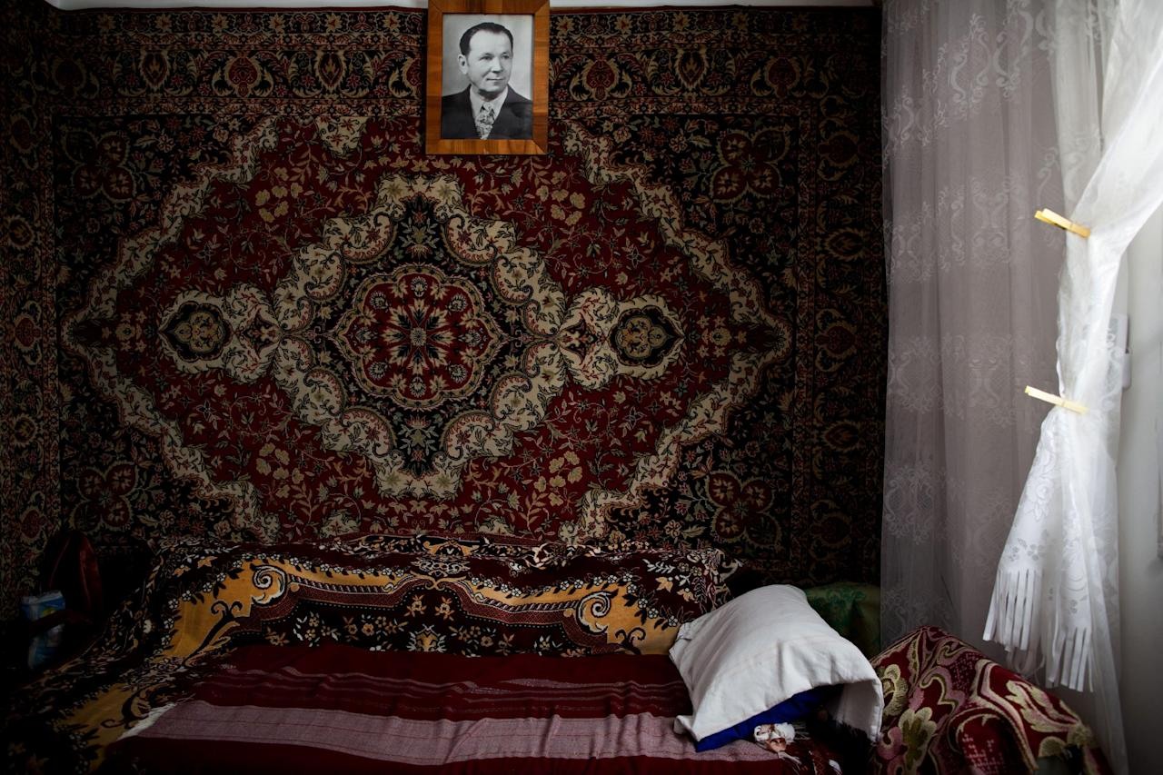 In this Oct. 30, 2012 photo, a carpet covers the bedroom wall in Tsila Gorenstein's apartment in Be'er Sheva, southern Israel. In her native Moldova, heavy carpets were hung on the walls to heat homes during wintertime, but in the scorching desert town of Be'er Sheva, the carpet is hung for decoration only. Israel has one of the world's largest Russian-speaking communities outside the former Soviet Union, and the immigrants' tenacious clinging to their old way of life has transformed the Jewish state. (AP Photo/Oded Balilty)