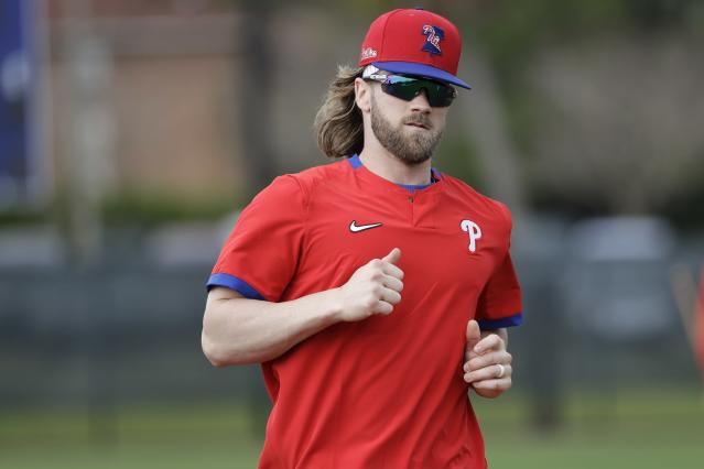 Philadelphia Philies' Bryce Harper runs during a spring training baseball workout Wednesday, Feb. 19, 2020, in Clearwater, Fla. (AP Photo/Frank Franklin II)