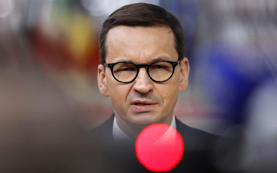 Prime Minister Mateusz Morawiecki speaks with the media as he arrives for an EU summit in Brussels in May. - EPA