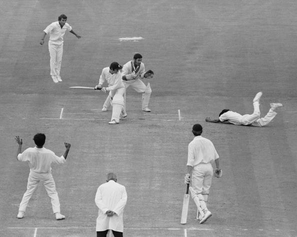 England's second innings on the fourth day's play of the Third Test at the Oval in London, 23rd August 1971. Indian fielder Eknath Solkar dives to take a catch from the bat of England's Alan Knott, off the bowling of S. Venkatarachavan for 1. The Indian wicketkeeper is Farokh Engineer. England were all out for 101 in their second innings, leaving India in a winning position with one day's plan remaining. (Photo by Central Press/Hulton Archive/Getty Images)