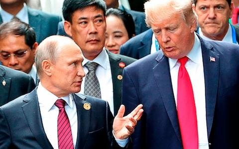<span>Trump and Putin, pictured a year ago</span>