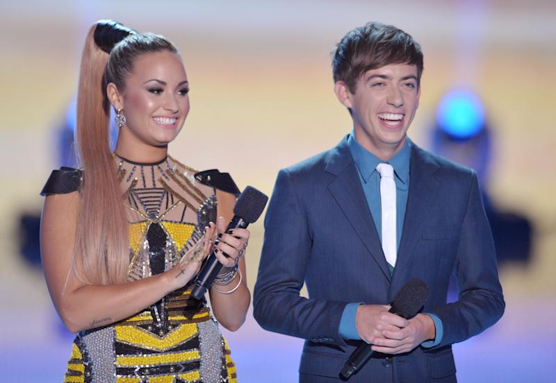 Hosts Demi Lovato, left, and Kevin McHale speak onstage at the Teen Choice Awards on Sunday, July 22, 2012, in Universal City, Calif. (Photo by John Shearer/Invision/AP)