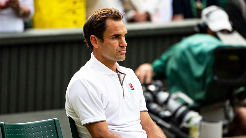 Roger Federer looking dejected after his loss at Wimbledon 2019 against Novak Djokovic.